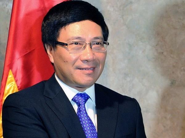 Entretien entre les deux ministres vietnamien et chinois des AE hinh anh 1