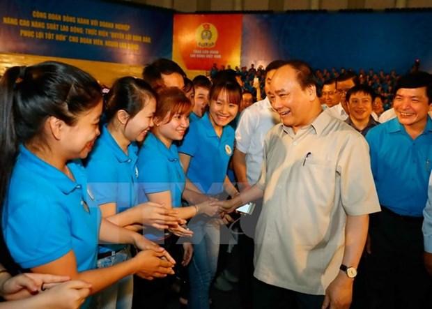 Dialogue entre le Premier ministre et des ouvriers du Centre hinh anh 1
