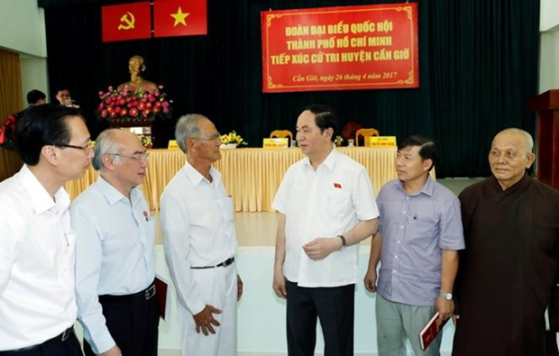 Le president Tran Dai Quang a l'ecoute des electeurs du district de Can Gio hinh anh 1