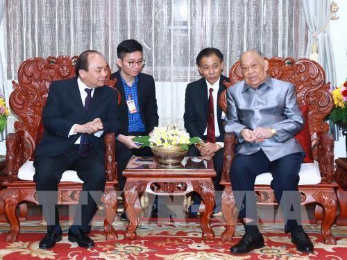 Le PM Nguyen Xuan Phuc poursuit ses activites au Laos hinh anh 1
