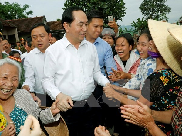 Le president Tran Dai Quang visite la commune de Nghia Dong, district de Tan Ky (Nghe An) hinh anh 1