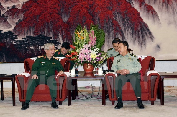Le vice-president de la Commission militaire centrale chinoise recoit le general Nguyen Chi Vinh hinh anh 1