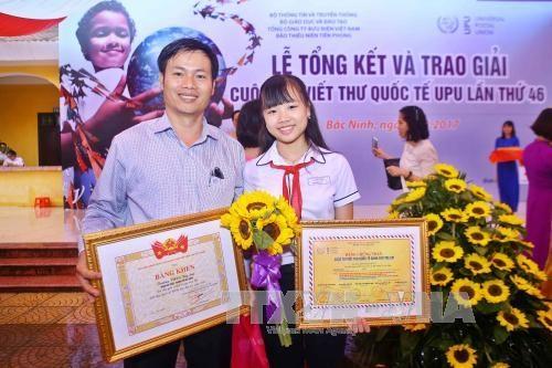 Celebration des 30 ans de la participation du Vietnam au concours UPU hinh anh 1