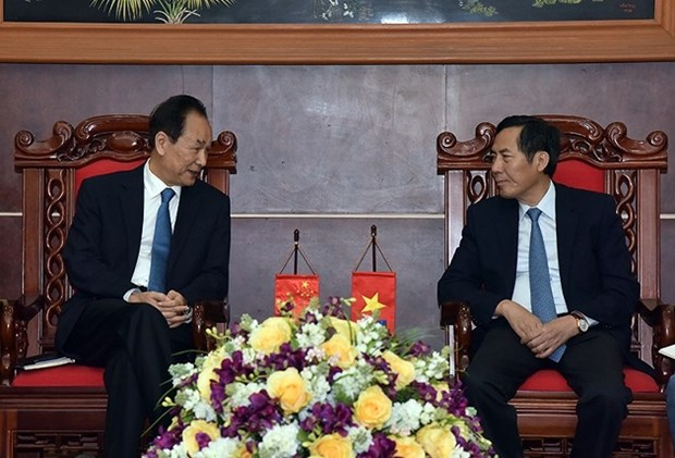 Le president de Xinhua travaille avec des responsables du journal Nhan Dan hinh anh 1