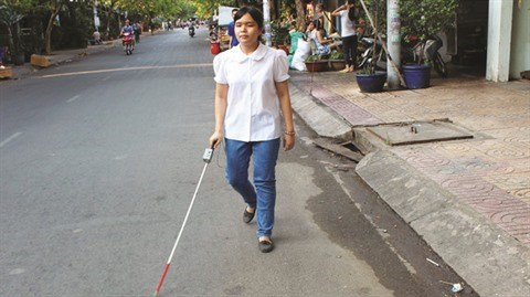 Une canne high-tech pour aveugles hinh anh 2