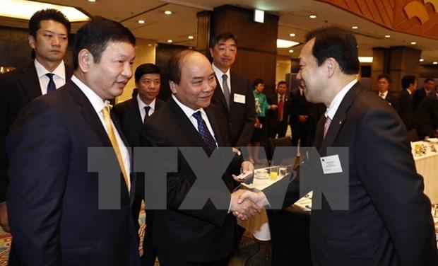 Le PM Nguyen Xuan Phuc au colloque avec les entreprises des TI du Japon hinh anh 1