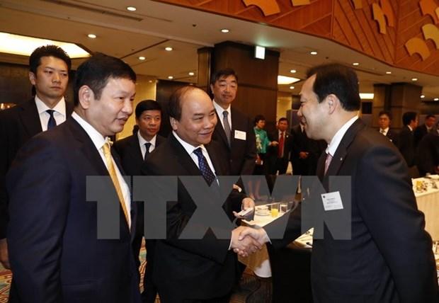 Les allocutions du PM Nguyen Xuan Phuc a Tokyo largement couverte par la presse japonaise hinh anh 1