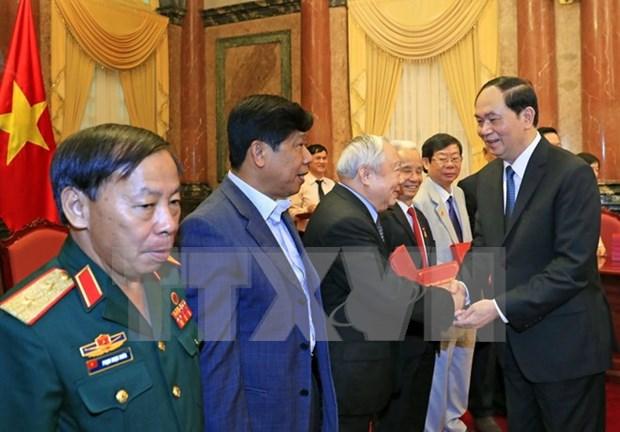 Rencontre du president Tran Dai Quang avec des soldats volontaires vietnamiens au Cambodge hinh anh 1
