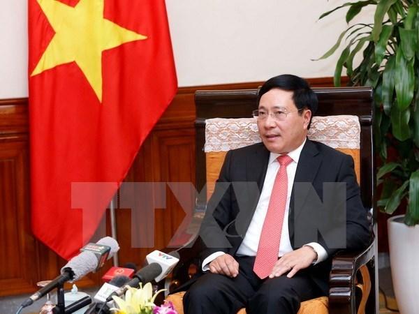 Le vice-PM Pham Binh Minh souligne la cooperation integrale Vietnam-Cambodge hinh anh 1
