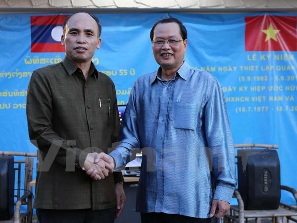 Echange d'amitie Vietnam-Laos a Singapour hinh anh 1