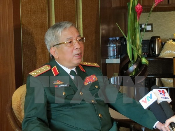 Le vice-ministre de la Defense Nguyen Chi Vinh recoit des hotes americain et sud-coreen hinh anh 1