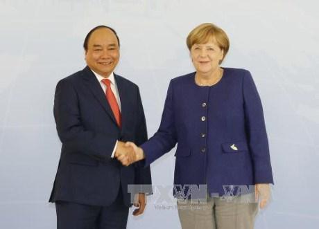 Entretien Nguyen Xuan Phuc – Angela Merkel hinh anh 1