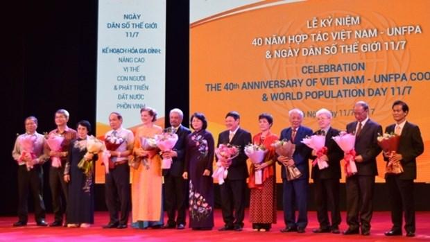 Celebration du 40e anniversaire de la cooperation entre le Vietnam et l'UNFPA hinh anh 1