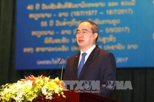 Celebration des 55 ans d'etablissement des relations diplomatiques Vietnam-Laos a HCM-Ville hinh anh 1