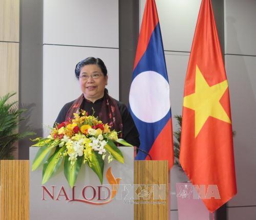 Echanges professionnels entre les deux bureaux de l'AN du Vietnam et du Laos hinh anh 1