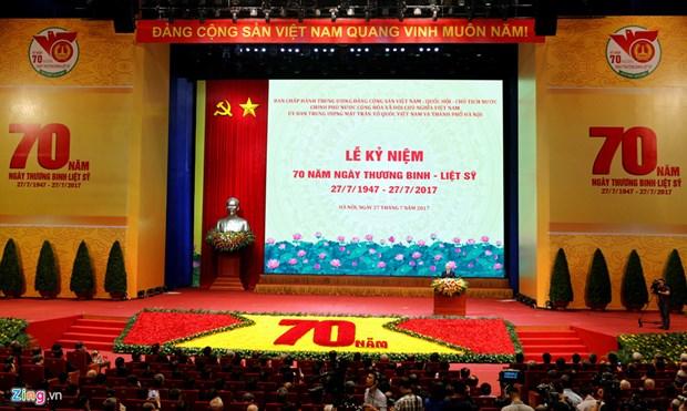 Celebration du 70e anniversaire de la journee des invalides de guerre et des morts pour la Patrie hinh anh 1