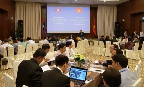 Colloque Vietnam - Laos sur la cooperation dans le travail et le bien-etre social hinh anh 1