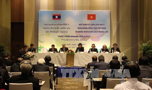 Cloture du colloque theorique entre le PCV et le Parti populaire revolutionnaire du Laos hinh anh 1