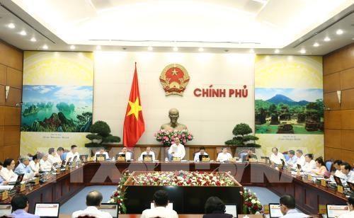 Continuer de regler les difficultes et promouvoir la production, selon le PM hinh anh 1