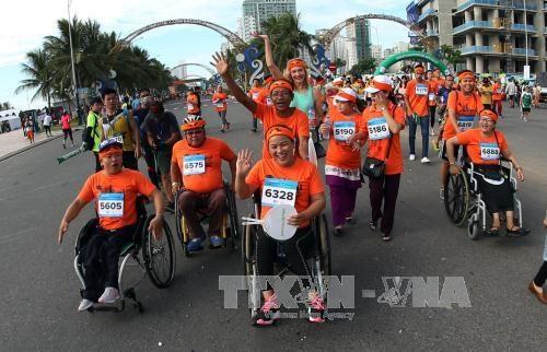 Plus de 5.000 coureurs au 5e marathon international de Da Nang hinh anh 2