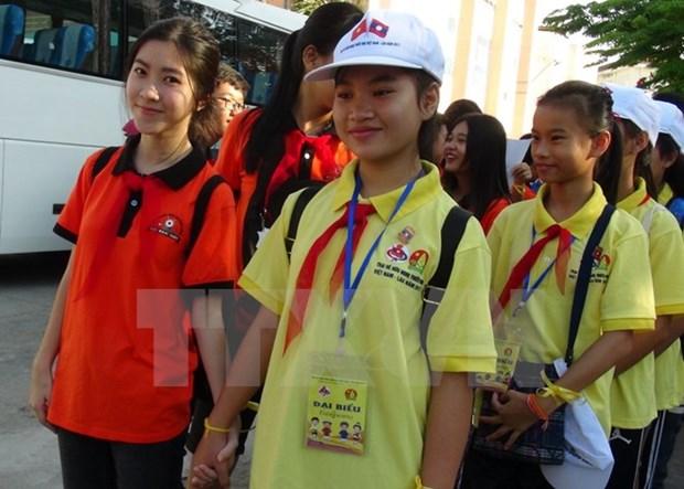 Les enfants vietnamiens et laotiens sont les heritiers des liens d'amitie entre les deux pays hinh anh 1