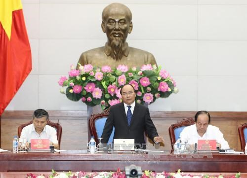 Le PM demande d'accelerer les reformes administratives pour booster la croissance hinh anh 1