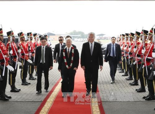 Le secretaire general Nguyen Phu Trong entame sa visite officielle en Indonesie hinh anh 1