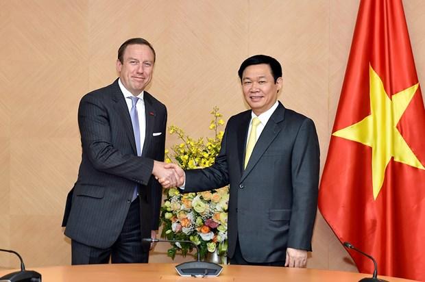 Le vice-PM Vuong Dinh Hue recoit le president de l'EuroCham au Vietnam hinh anh 1