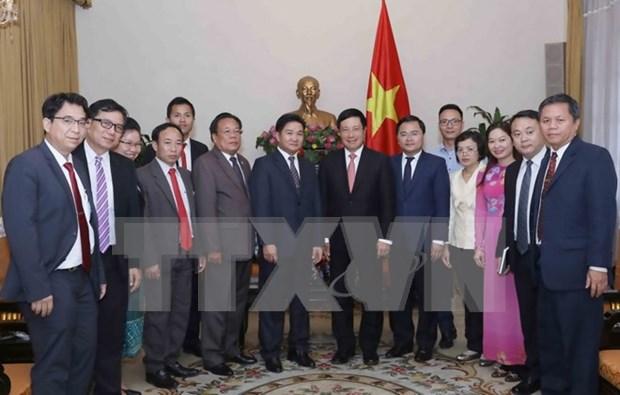Le vice-PM Pham Binh Minh recoit la delegation de l'Union de la jeunsse du Laos hinh anh 1