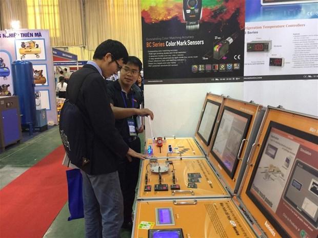 Ouverture des expositions de produits industriels et de bois a Hanoi et HCM-Ville hinh anh 1