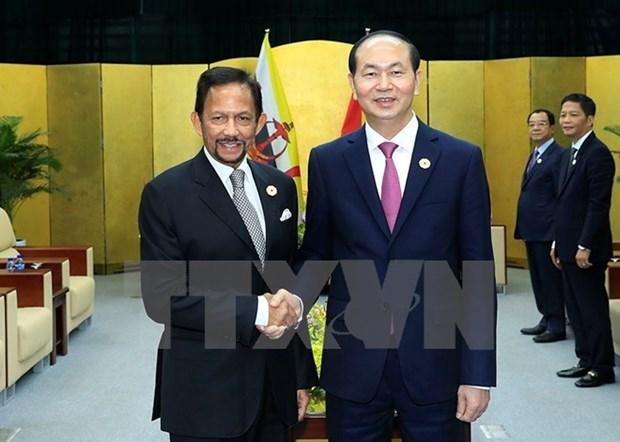 Le president Tran Dai Quang recoit les Premiers ministres du Japon et du Brunei hinh anh 2