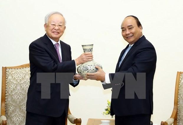 Le Premier ministre Nguyen Xuan Phuc recoit le president du groupe sud-coreen CJ hinh anh 1