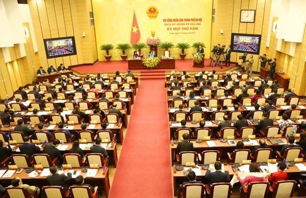 Le Conseil populaire de Hanoi adopte plusieurs questions importantes de la ville hinh anh 1