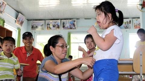 «Maman Yo», militante devouee du handicap hinh anh 2