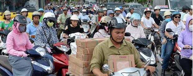 Le port du casque au Vietnam vu par les medias internationaux hinh anh 1