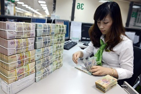 Banque d'Etat du Vietnam : pas de penurie d'especes a l'occasion du Tet 2018 hinh anh 1