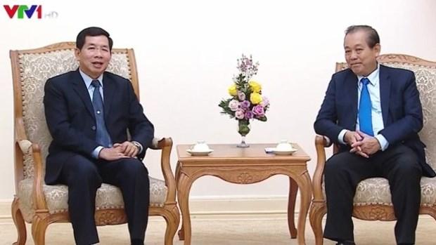 Le vice-PM Truong Hoa Binh salue la cooperation judiciaire entre le Vietnam et le Laos hinh anh 1