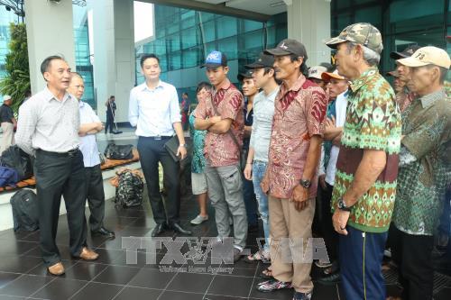 Plusieurs pecheurs arretes en Indonesie rapatries au Vietnam avant le Tet hinh anh 1