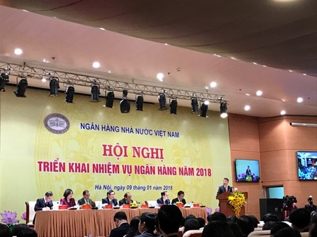 Le Premier ministre Nguyen Xuan Phuc a une conference de la banque d'Etat hinh anh 1