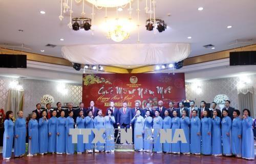 Les Vietnamiens au Laos et au Canada saluent le Nouvel An lunaire hinh anh 1