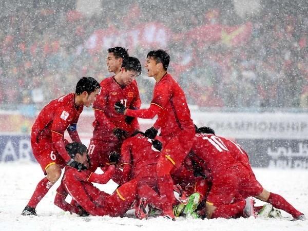 Les medias internationaux impressionnes par l'accueil de l'equipe vietnamienne U23 hinh anh 1