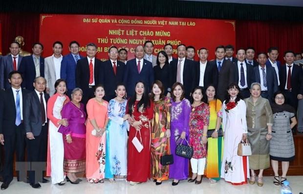 Les PM vietnamien et laotien a la celebration du Tet traditionnel a Vientiane hinh anh 1