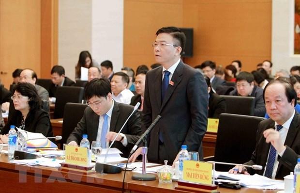 Pour regler la lenteur dans la promulgation des textes juridiques hinh anh 1