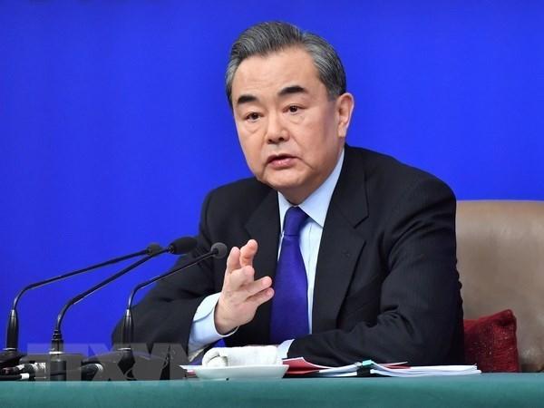 Felicitations a Wang Yi pour sa nomination en tant que conseiller d'Etat de la Chine hinh anh 1