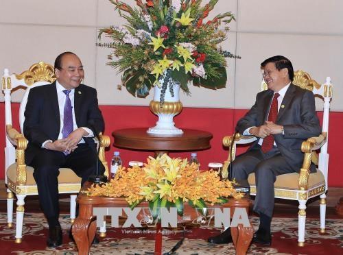 MRC : rencontre entre les Premiers ministres vietnamien et laotien hinh anh 1