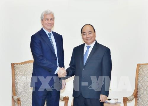 Le PM recoit le president du groupe americain J.P. Morgan hinh anh 1