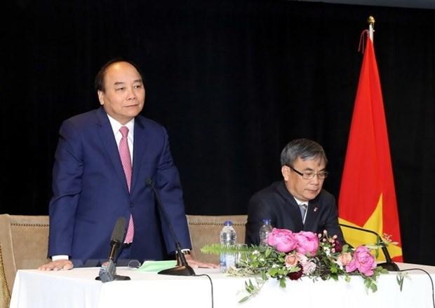 Le PM Nguyen Xuan Phuc rencontre des Vietnamiens residant au Canada hinh anh 1