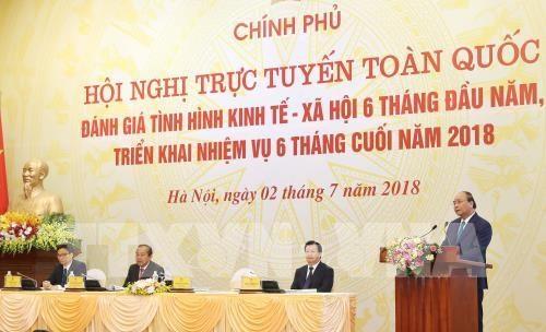 Videoconference nationale entre le gouvernement et les localites hinh anh 1