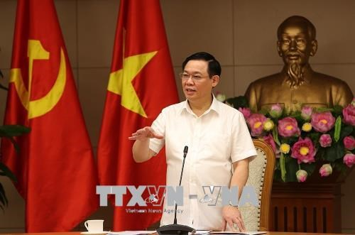 Le vice-PM Vuong Dinh Hue appelle a maitriser l'inflation hinh anh 1