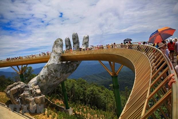 Les medias de masse etrangers font l'eloge du pont d'Or a Da Nang hinh anh 1